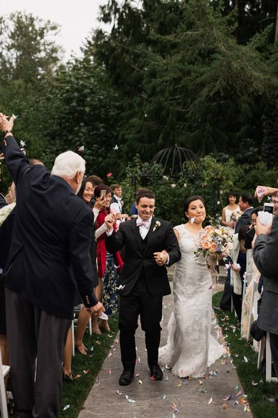 Bride and Groom dance their way down the aisle as paper cranes are thrown