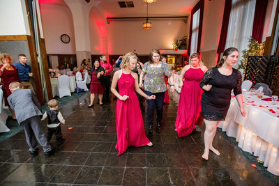 Wedding guests gathered on the dance floor of the Concourse at Union Station