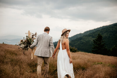 bride and groom on a mountain top