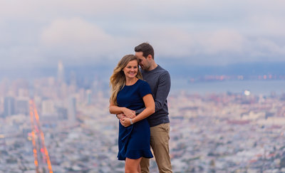 A Vancouver sunset engagement photo by the Vancouver Convention Centre