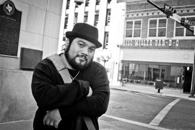 David Castillo of Expose The Heart Photography standing downtown in Main Plaza after a photoshoot