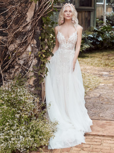 Boho Tulle A-line Wedding Dress. A portrait of a lady-a bride who knows what she likes, at the height of her style game, wearing a boho tulle A-line wedding gown inspired by big bouquets and summer celebrations.