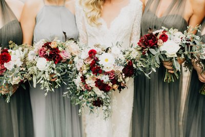 Bride and Bridesmaids with red blush white bouquets