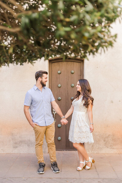 engagement session with couple holding hands