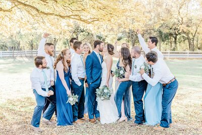 Dallas bridal party cheering for newlywed kiss