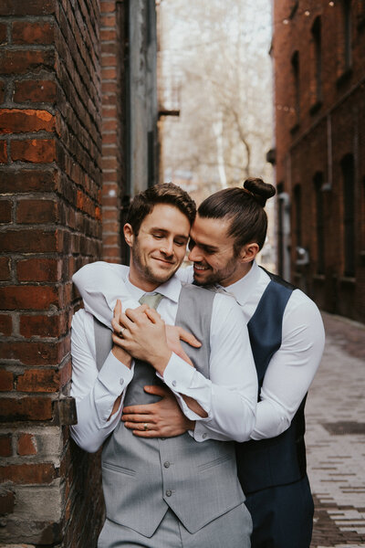 Romantic gay couple in downtown Seattle by Seattle Wedding Photographer Sarah Anne Photo