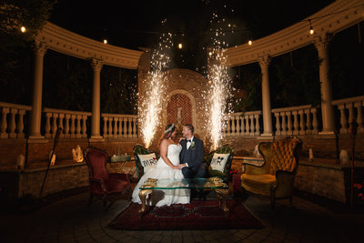 Brownstone Wedding Reception Bride and Groom Pose in Front of Fireworks During their Paterson New Jersey Wedding Photo Shoot
