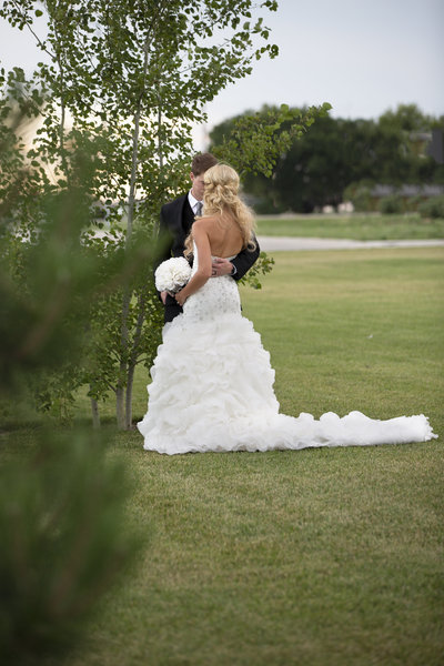 Bride and groom share a moment  outside Holtus Convention Center in York, NE