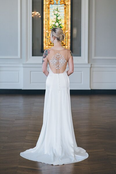 Photo link to more details about the Iset charmeuse wedding dress with an illusion back