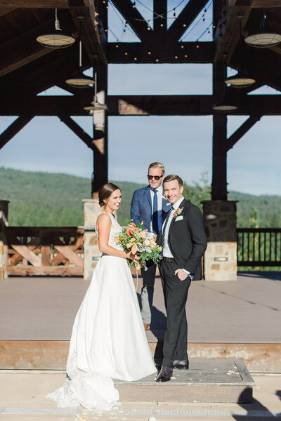 bride and groom looking at guests during ceremony at swiftwater cellars