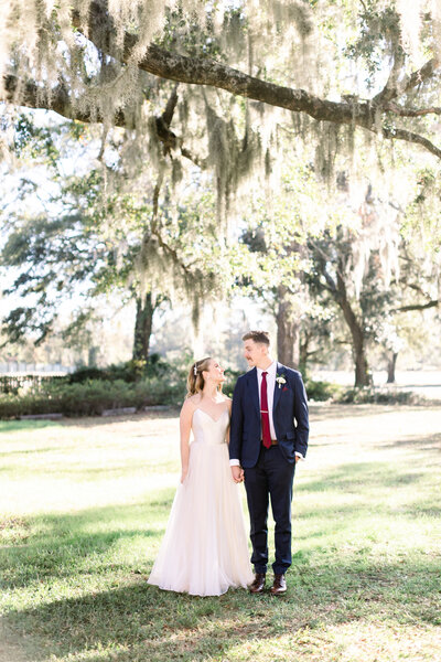 Becca and Ross wedding portraits under the oak tree at wrightsville manor