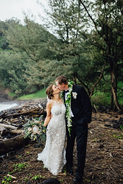 bride and groom at pololu valley elopement