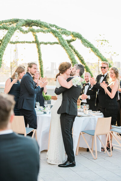 bride and groom share a kiss at brooklyn wedding in ny