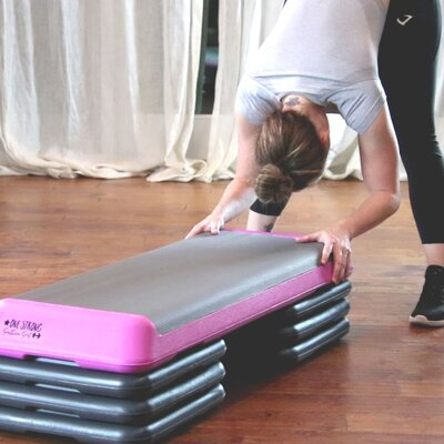 forward fold with pink aerobic step