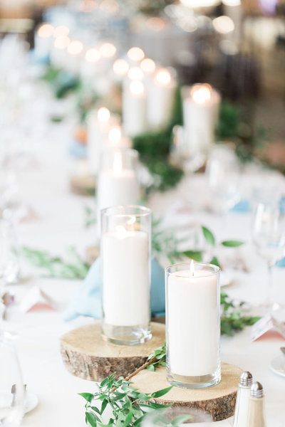 Beautiful wedding tablescape with candles and greenery
