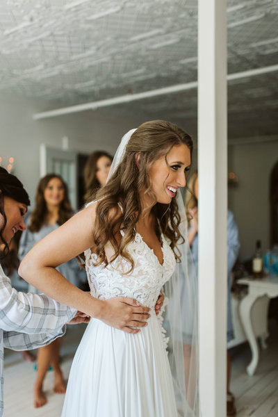 bride-admires-dress-at-the-Ravington-bridal-room