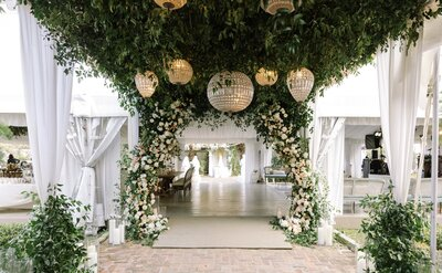Reception Tent Entrance of floral arch and chandeliers