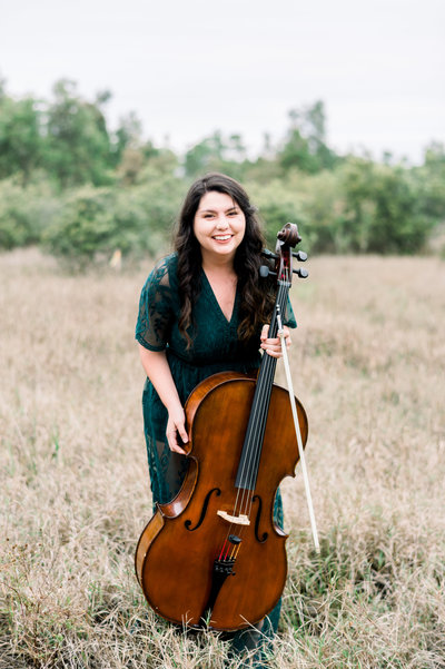 girl smiling with cello
