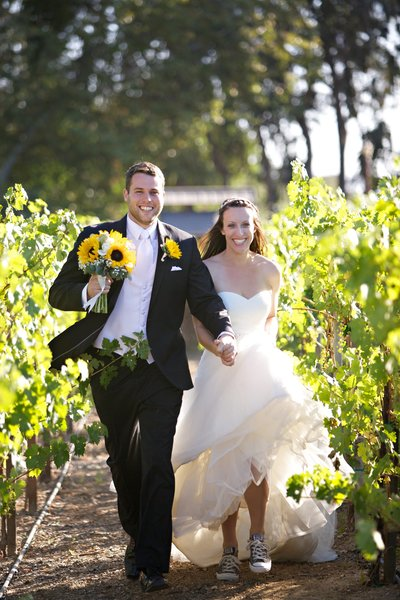 Bride and Groom running in the vineyard at Lake Oak Meadows