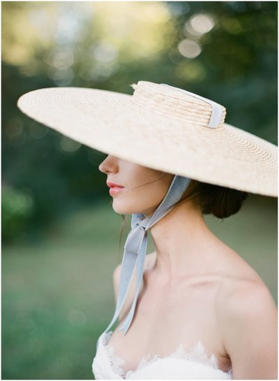 bride wearing a hat on het wedding day in France