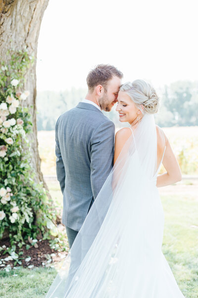 Wedding Couple Snuggling at Dreamy Deer Flat Ranch Wedding
