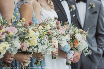 Wedding photographer jamie lucido captures side view of bridal party and bridal bouquet