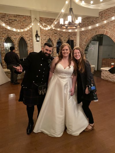 Alexandria Salmieri takes photo with couple  Allisha and Stan at their Historic Maxwell Room wedding