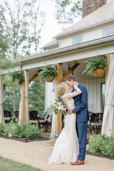 bride and groom kiss at mountain wedding venue