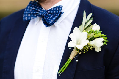 white boutenniere on grooms navy suit, southern wedding