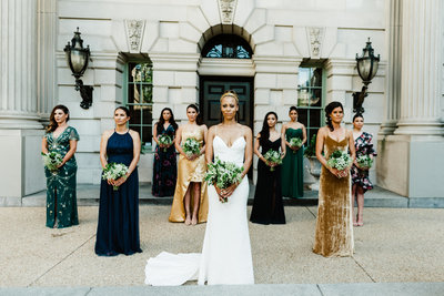 bridesmaids at the larz anderson house in washington dc standing in formation a la the solange knowles wedding bridesmaids photos where they are not smiling and are just standing and posing