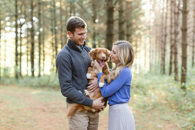 Couple holding dog Toller