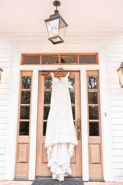 Photo of a wedding dress hanging at the Carl House by Jennifer Marie Studios.
