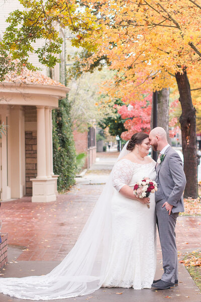 A bride and groom pose at their Sterling Hotel wedding in Downtown Sacramento, CA