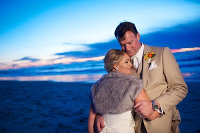 Bride and Groom on beach with shall and blue sunset at Darlington House