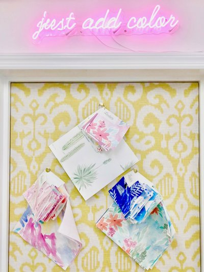 A pink neon sign to just add color above a yellow damask bulletin board.