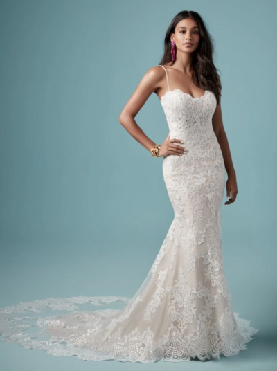 Sheath Wedding Gown Favorite Romance is captivated in this delicate sheath wedding gown with lace motifs adorning throughout. An illusion sweetheart neckline detailed with delicate lace edging, and a beautiful illusion double train complete this strapless tulle wedding dress. Finished with covered buttons over zipper closure. Includes detachable beaded shoulder straps.
