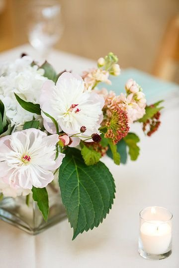 Spring wedding centerpieces with locally grown peonies.  Photo by Greenhouse Loft Photography.