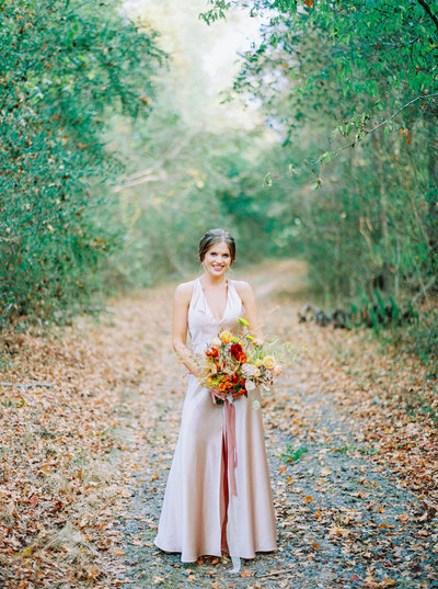 Fall wedding bridal portrait with an apricot wedding dress and textured flowers