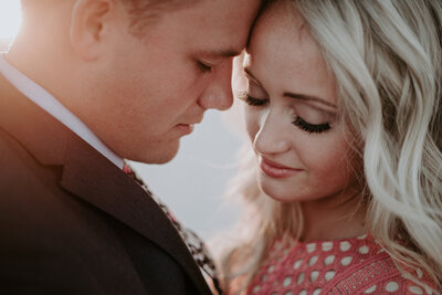A couple shares a romantic moment during their engagement photos.