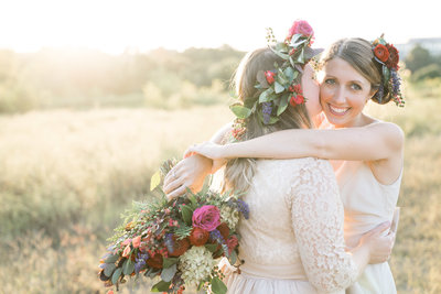 Charlotte wedding photographer shot of brides in field in uptown charlotte