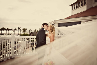 Beautiful couple kissing at Hotel Del in San Diego