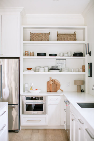 white kitchen with beautifully styled floating shelves