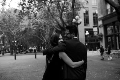 Couple hugging and walking during their engagement session