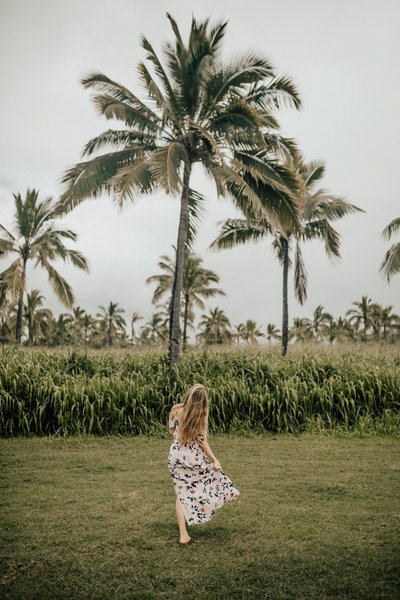 woman by palm trees
