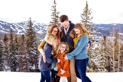 Loving family image in the snowy mountains
