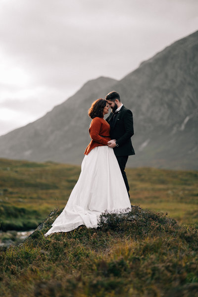 Newly wedded bride and groom in Glencoe, scottish highlands, UK