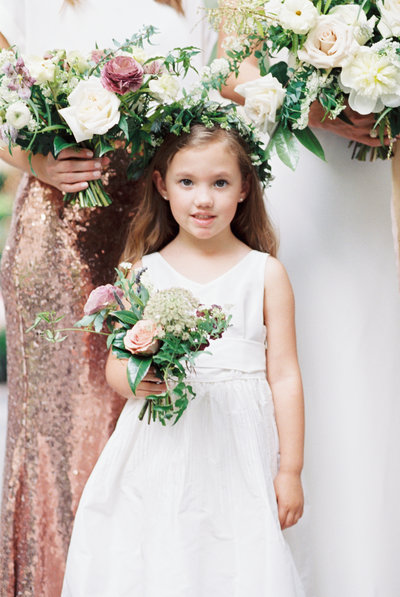 wedding family photo junior bridesmaid holding bouquet next to sequined bridesmaid skirt at hotel crescent court wedding by catie ann photography