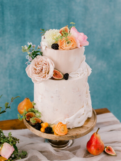 natural wedding cake with flowers and fruit