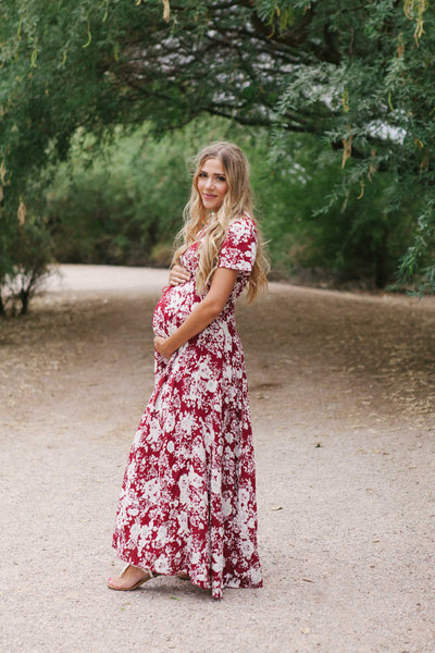 maternity session with red floral dress at gilbert riparian preserve
