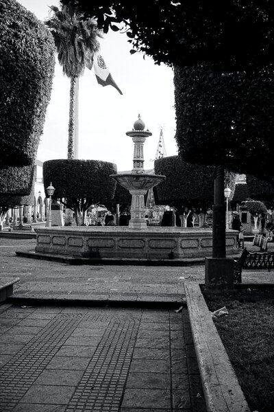 Traditional Mexican city plaza with fountain in the state of Michoacan